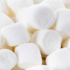 White Fluffy Round Marshmallows as a background. Sweet  Food Ca