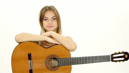 An attractive young teenage woman with an acoustic guitar on