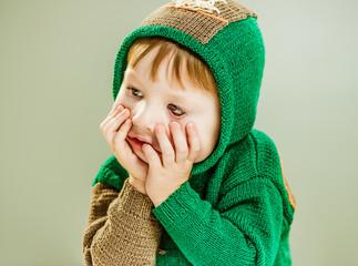 upset boy portrait in a hood