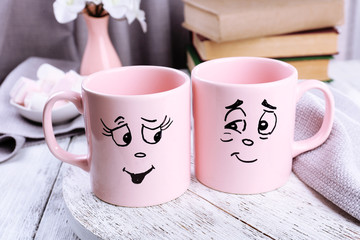 Emotional cups on wooden table