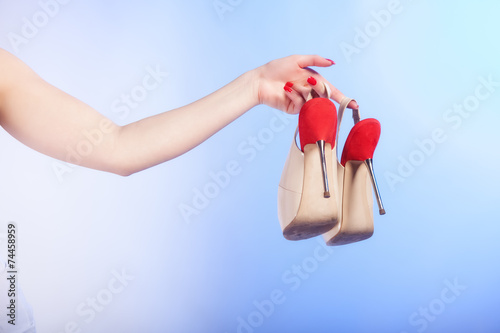 canvas print picture female shoes high heels in woman hand. Shopping.
