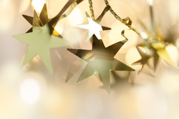 Christmas background with bokeh and garland of stars