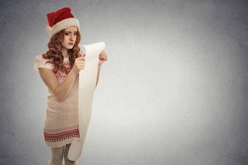 Christmas woman Santa Claus hat holding wish list stressed
