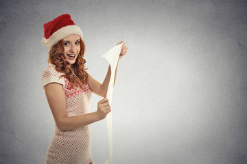 young attractive girl santa helper holding reading wish list