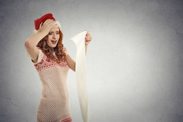 Christmas woman red Santa hat holding long wish list stressed