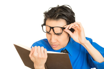 man who can't see, read book, has vision problems wrong glasses