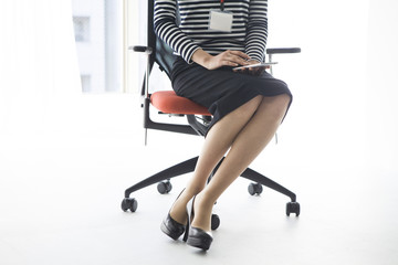 Woman sitting in the office