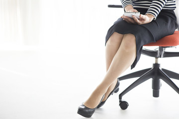 Woman sitting in a chair, have a cell phone