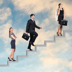 Three business people walking on the ladder