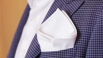 Handkerchief pocket of his jacket