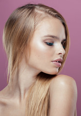 young pretty blonde woman with hairstyle close up and makeup on