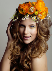 Beauty young woman with flowers and make up close up, real