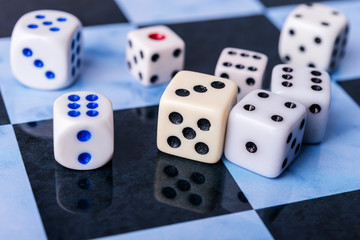 dice on chess board, mix of game close-up