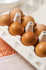 Fresh brown eggs in carton