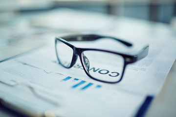 Eyeglasses on document