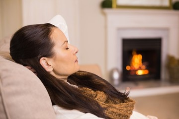 Pretty brunette relaxing on the couch at christmas