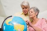 Senior couple choosing a travel destination