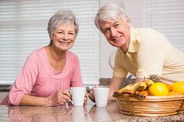 Senior couple having coffee together