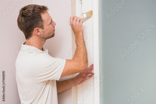 canvas print picture Painter painting the door white