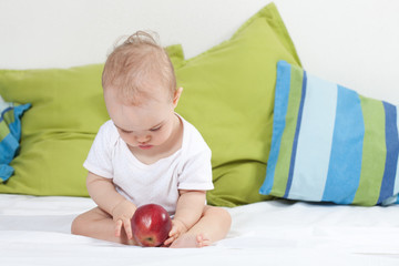 Baby girl with apple