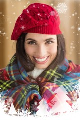 Composite image of smiling brunette with cover and red hat