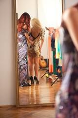Girls trying wardrobe in dressing room