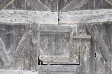 Wooden door on farm wall in France