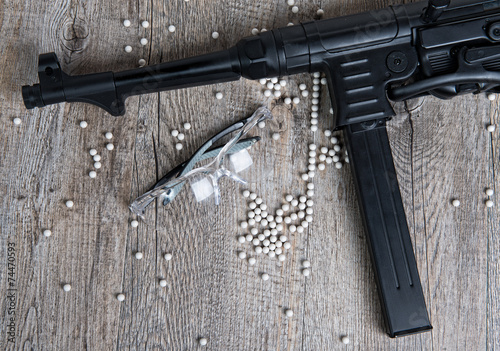 airsoft gun with glasses and lot of bullets - 74470593