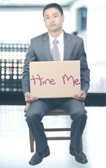 Unemployed young man with placard