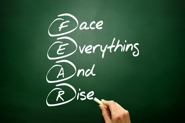 Face Everything And Rise (FEAR) acronym on blackboard