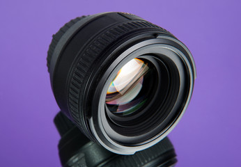 photographic lens with a reflection