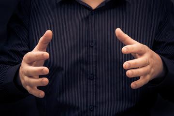 Man gesture showing size something