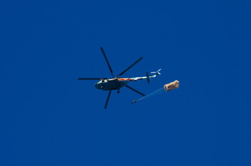 Helicopter and the parachutist