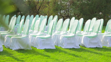 Chairs Decorated With White Cloth for the Wedding Ceremony