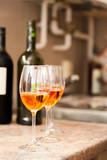 Glasses of rose wine - shallow DOF, enhanced colors poster