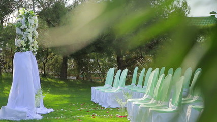 Decorated Chairs And Arch    At Wedding Ceremony