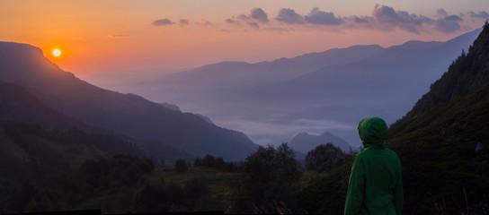 Rising sun in mountains
