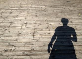 my shadow on wood floor