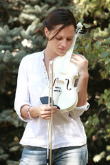 Girl and white violin