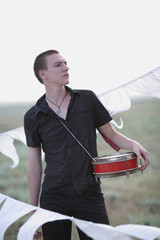 young man with a drum