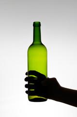 Female hand holding a bottle