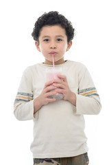 Happy Young Boy Drinking Milk Shake