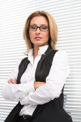 serious business woman in white shirt.