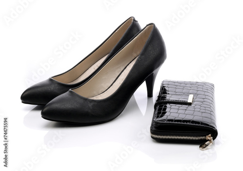 Women's shoes and a black wallet on a white background - 74475594