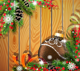 Brown Christmas ball on wooden background