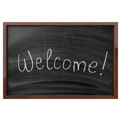 Word Welcome Written On Blackboard
