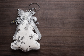 handmade toy christmas tree on the wooden background