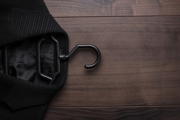 black suit on the wooden background