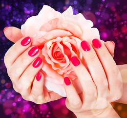 manicure and rose on beautiful background