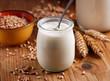 yogurt bianco con cereali nel barattolo di vetro - 74478743